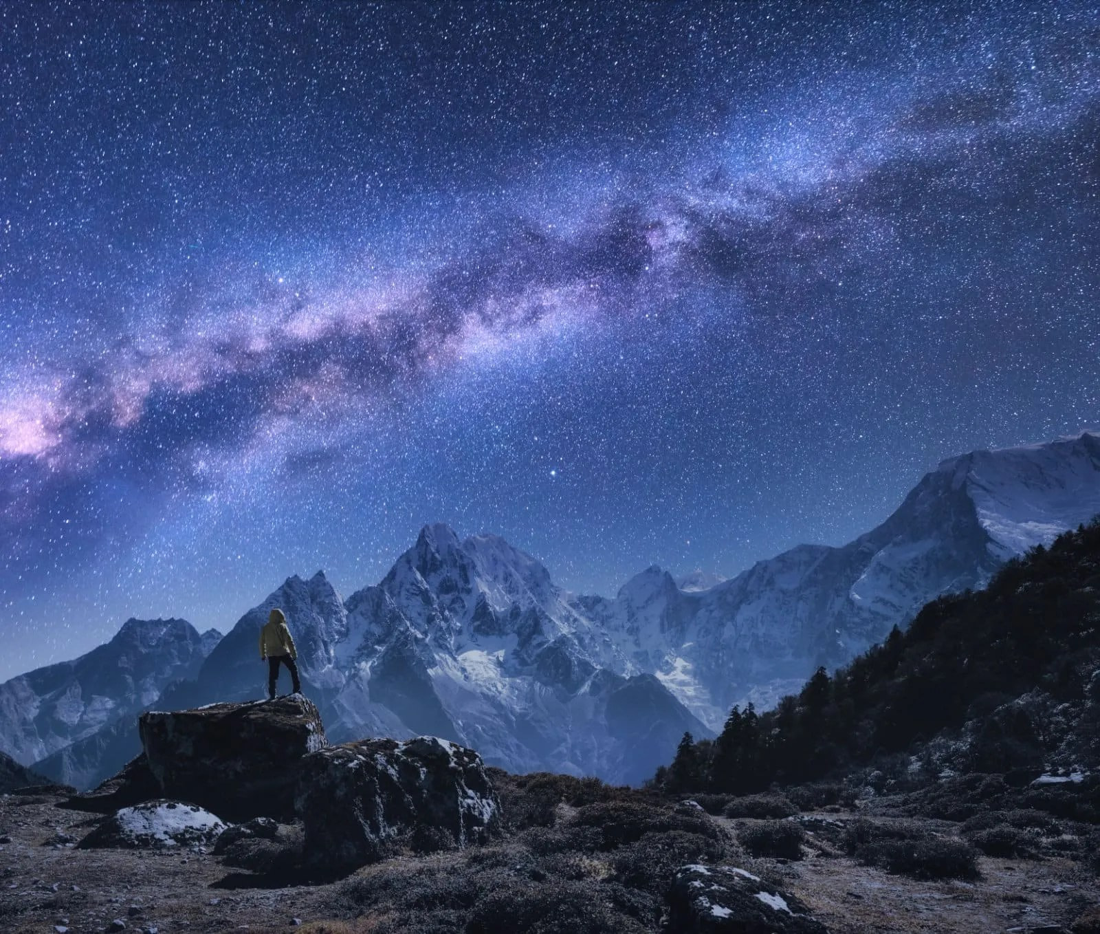 Adventurer under the stars, finding themselves in the healing meditation of being awed by a moment in time.